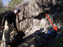 """The base of the route. Red arrow points to the obscure """"cairn"""" lying there."""