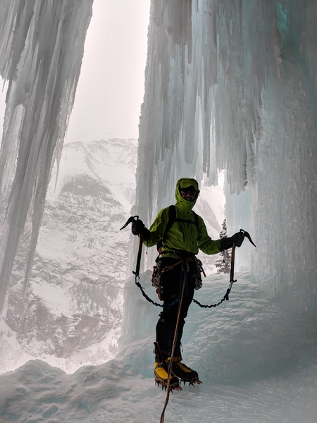 The belay at the top of the second pitch is bolted and is behind the waterfall curtain.  The exit to start the third pitch is out the window (right side of picture).  Vik Sahney about to lead P3.  Taken on 2/3/2018