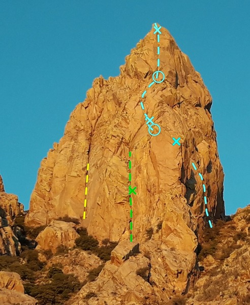 West aspect of Lesser Spire from approach gulley<br> <br> Yellow - Losleben's Crack <br> Green - First pitch of West Face, X is approximate location of bolt ladder. The old Eagle's nest is at the top of the green line <br> Blue - La Fissura del Cielo. Lower X is old rappel anchor on the east face of the a pinnacle. Other X's are old 1/4 in. bolts. Pitch 1 and 2 and the very top slab might be shared by another unknown route.