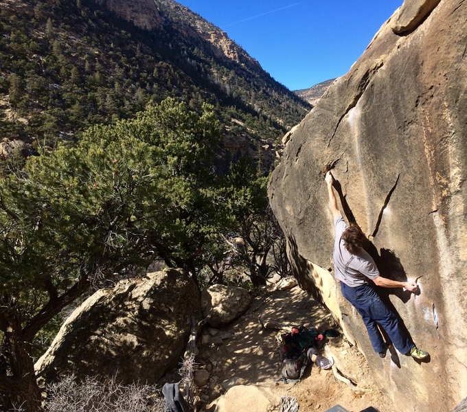 Zach moving to the pocket on this amazing boulder