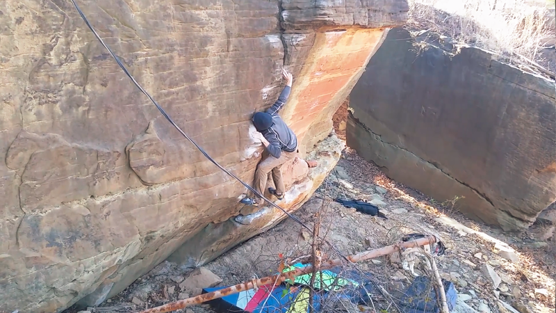 Struggling to move through the tricky crux.