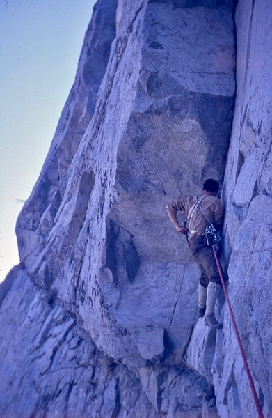 "Ray Palmer starting the first pitch of ""Godzilla's Revenge"" in 1969 - a short traverse to the ""Goose neck"" corner. (not quite this steep)."