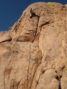 Climber on Taste the Rainbow.  SunDrop is the line to the right of climber