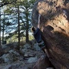 Hitting the first hold (the lower crimp) on Hagan's Wall.