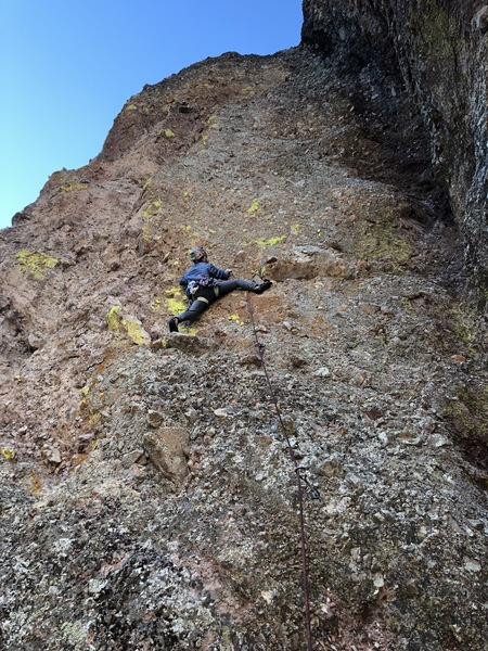 Alex testing the holds on the pumpy crux section of P1.