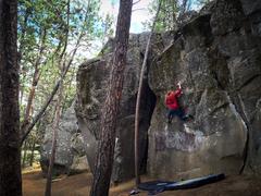 Kelly Williams climbs &quot;The Wizard&quot; V7. <br />Photo Duncan Van Horn
