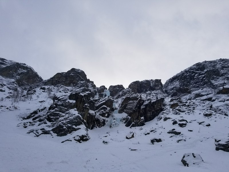 The view of Patri from the approach.  The track to reach L' Acheronte can be seen leading up and right.<br> <br> Upper pitches of L' Acheronte are also visible high up to the right.