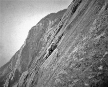 Henry Barber traversing onto the great flake section above Labyrinth Wall and the VMC First Ascent 1973 In the background The Whitney Gilman Ridge
