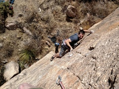 Trying hard pulling the powerful and sequential first crux after falling off of it at least 3 or 4 times. Amelia Whalen photo.