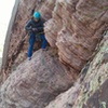 Showing our topout traverse.  I believe the varnish behind the climber is the original line (traversing left instead).