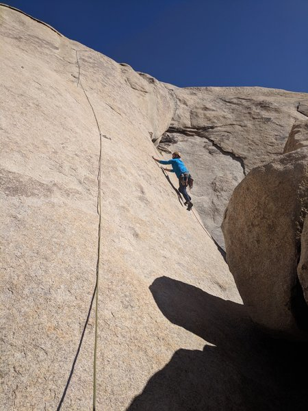 Contemplating the crux moves between the first and second bolt.