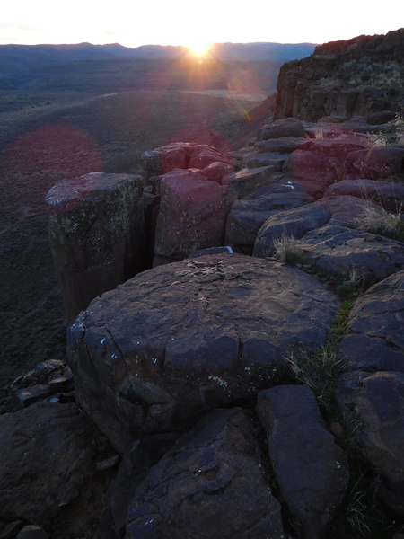 setting sun over hexagons.