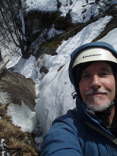 Egotistical Selfie, looking straight down from the top of the route. The diagonal snow pile lies on the ledge where I ran out of rope on the original ascent. I had to literally leap off that ledge and slam my axes into the turf to get to a tree and escape.