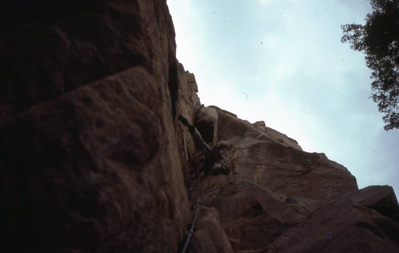 EBs were worn by GB, during the likely first ascent of this big dihedral, early April, 1977. Tim Loften and I rated it 5.8, which is old-school by today's standards. I'll name it later.<br> <br> Edit: this pic was taken from the ground by Tim Loften.