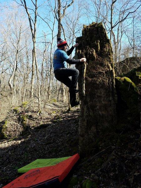 Steve climbing up the arete