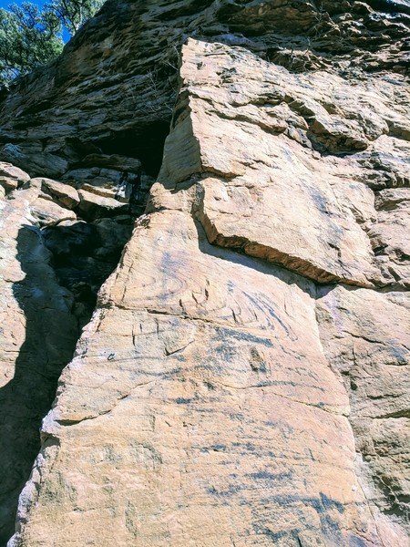 Start on the left side of the arete and make your way up to the anchors just below the massive ledge.