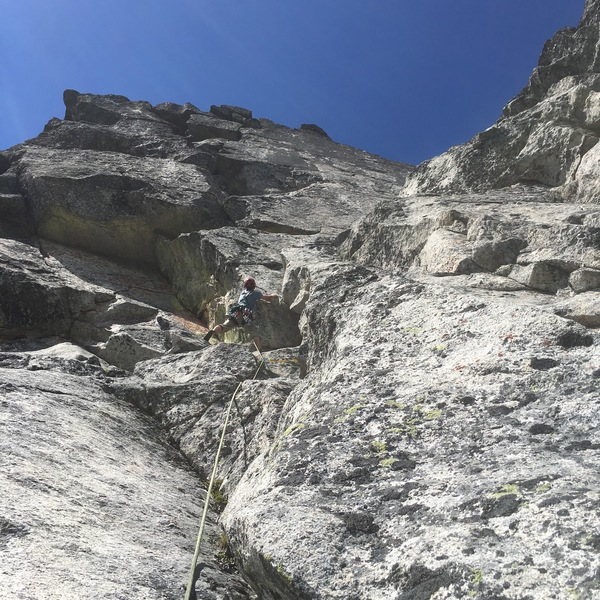 The Keystone route is seen just up and left of the climber who for a few more moves, remains on the SR.