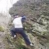 Steve maneuvering around the bulge on the Treasure Map (V3+) traverse on Treasure Island boulder.