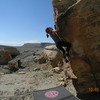 Shyanne Williams FA of the V3 arete problem. Monkey Face boulder is on the left in the background.