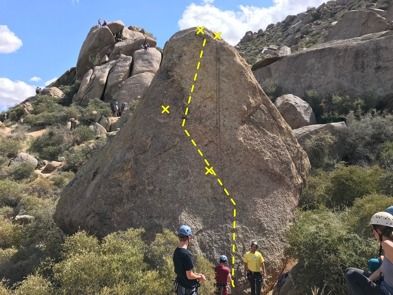 The route zig zags a but generally follows up the middle of the boulder