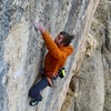 Moving to the sidepull crimp at the last bolt. The rock is amazing on this one!<br>  Taylor Spiegelberg photo.