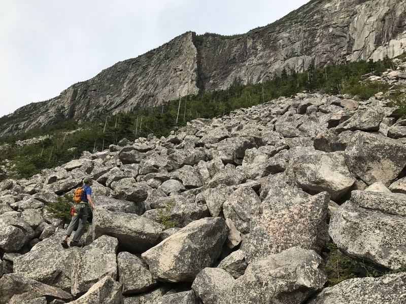 Jim Shimberg crosses the talus en route to the Whitney-Gilman ridge on Cannon Mountain.