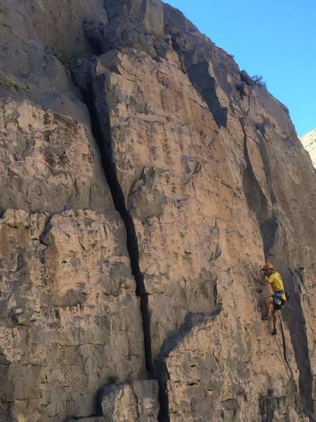 "Tom Grundy on an early ascent of ""Pink Panther"""