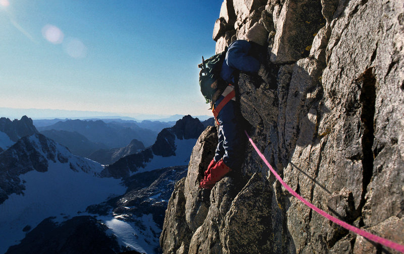 Mary Erdei dealing with really stout wind at the end of the day .near the top of the upper ridge. Most of the descent was done in the dark. Sept 1980