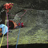 Rains belaying Hud on day 2 as we work our way thru the overlaps above the bivy ledge. November 1974