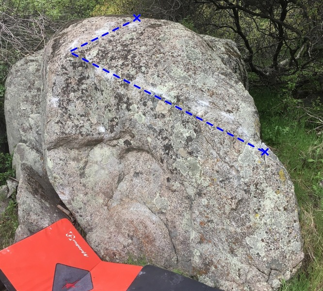 Just cleaned up this boulder. Probably around a V3-V4. Crimps to a Slopper finish.