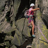 Chuck Timchalk on the sketchy crux pitch - Aug 1995. Notice recent rock fall below him.