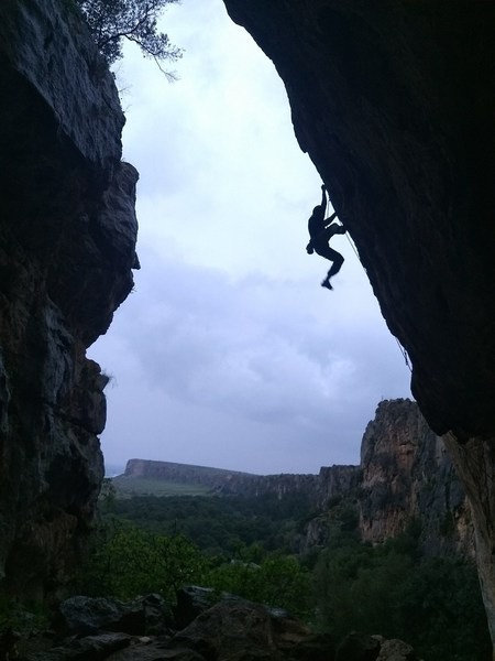 Some Austrian climber on Menage a Trois (I think) on a rainy day (route stays dry)