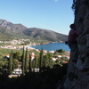 """RW climbs """"Kastraki"""" with the town of Kyparissi in the background"""