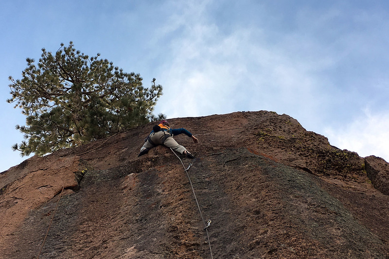 the gazelle doing crux moves off the ledge, note that it is possible (and easier) to go up further left.