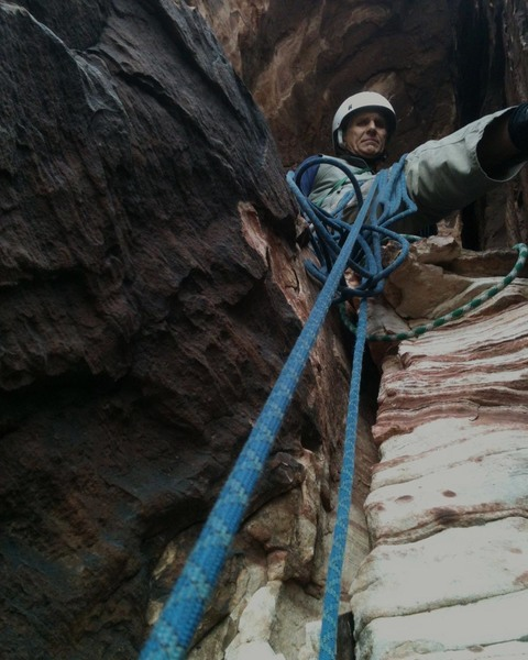 Belaying beneath the big overhang on Working Class Heroes