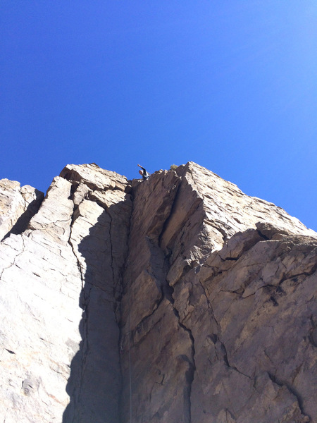"Topping out on the first ascent of ""Book of Runes"""