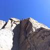 """Topping out on the first ascent of """"Book of Runes"""""""