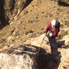 Allie Burnett topping out on the first ascent.