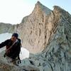 Posing with the awe-inspiring ridge traverse of Conness' North Ridge behind.