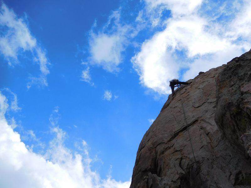 Climber at the anchors of Shoot at Will (5.8), Holcomb Valley Pinnacles