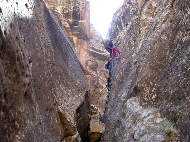 The rappel lines into the climbing area.
