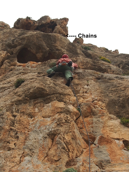 """RW leading through the first """"cruxy"""" section of Bara.  Note chains above overhang."""