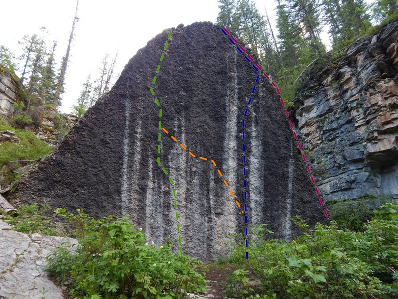 Druid Stone, North Face: #Green 5.13aR *** 1st one climbed with out a rope, crux mid-height, finish deeper pockets.# Orange: Project *** # Blue: 5.13bR *** distinct crux 3/4 height, moving right. # purple: 5.11 right edge