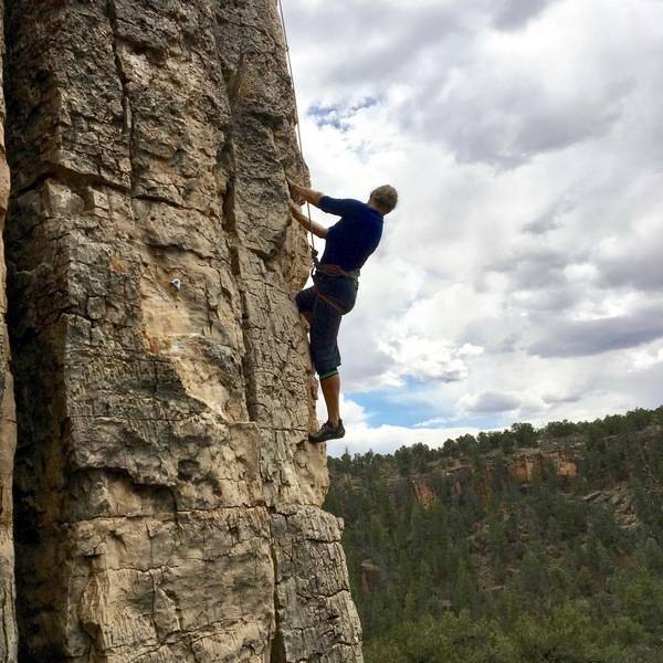 Sibylle toproping Unknown, 5.9, on a breezy April day.