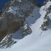 Skinning below the N couloir of Feather Peak