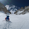 Booting up the N couloir of Feather Peak