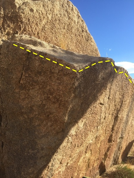 The start of the traverse (left most edge), the first corner to round (middle), and the longer side of the boulder (right).