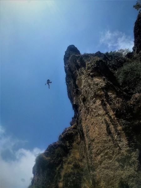 Rappelling off.