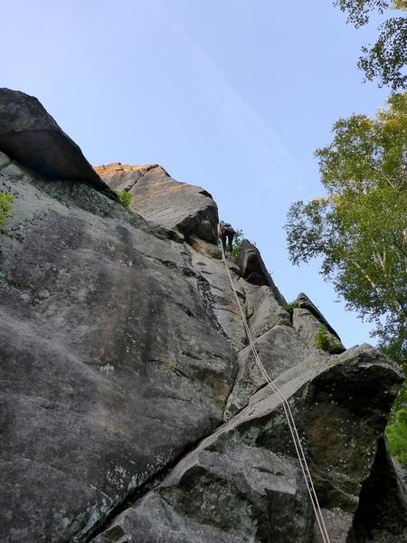 L'Arête des Urubus is on top of the climber on the right side of the arête, under the climber it's L'Hypoténuse.