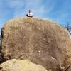 Preston Pettigrew atop Steak Dinner Boulder for scale